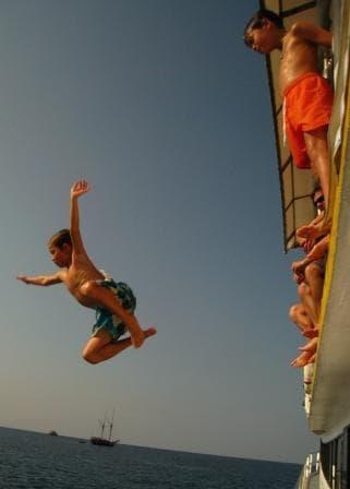 Children jump off Oktavia Similan Islands liveaboard